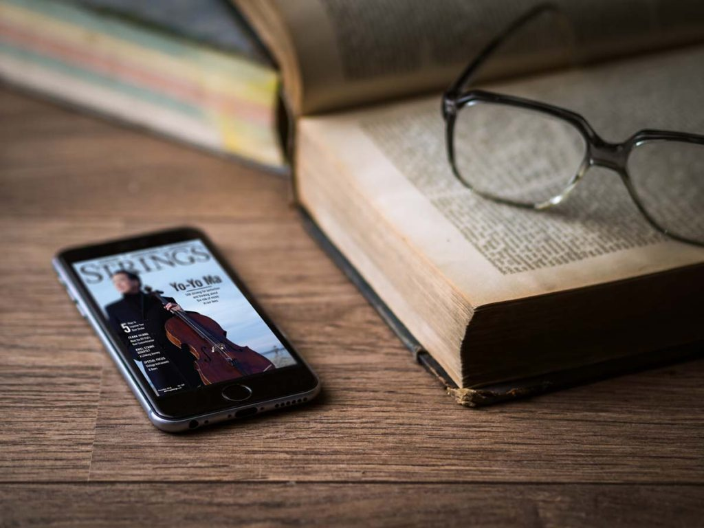 strings-magazine-mockup-iphone-on-vintage-table-glasses-and-book
